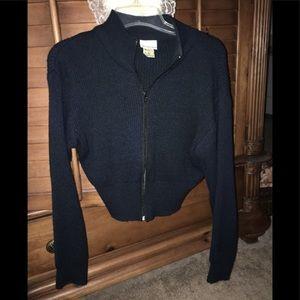 Black waist length sweater zipper closure